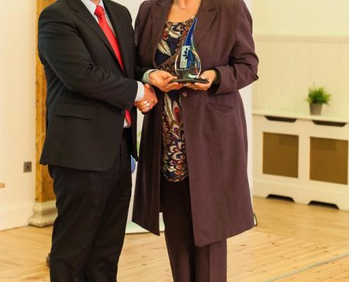 Leo Kearns presenting the HMI Leaders Award to Alison Dougall